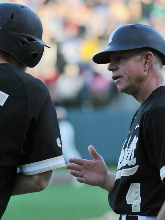 Vanderbilt's head coach Tim Corbin talks with Conrad Gregor on third base during a game against Belmont's at Hawkins Field on May 14, 2013.