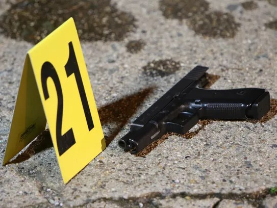 A gun sits by a marker on Jan. 8, 2016, following a
