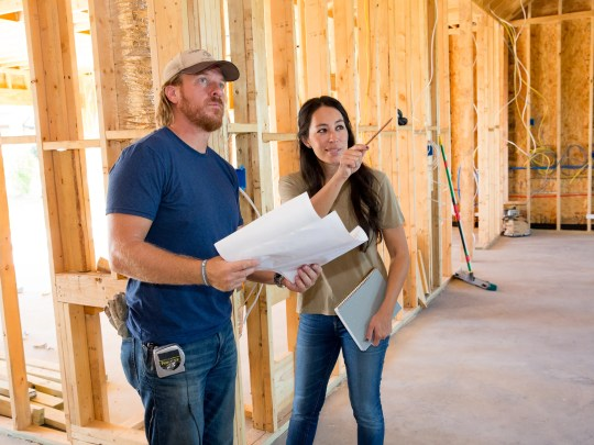 Joanna Gaines and her husband are checking the progress