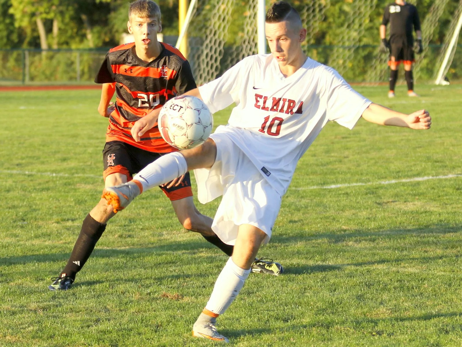 97779500962c Logan Brimmer of Elmira prepares to kick the ball while Union-Endicott s  Nazar Fedorchuk fight