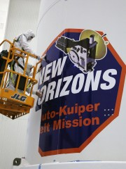 Technicians install strips of the New Horizons mission