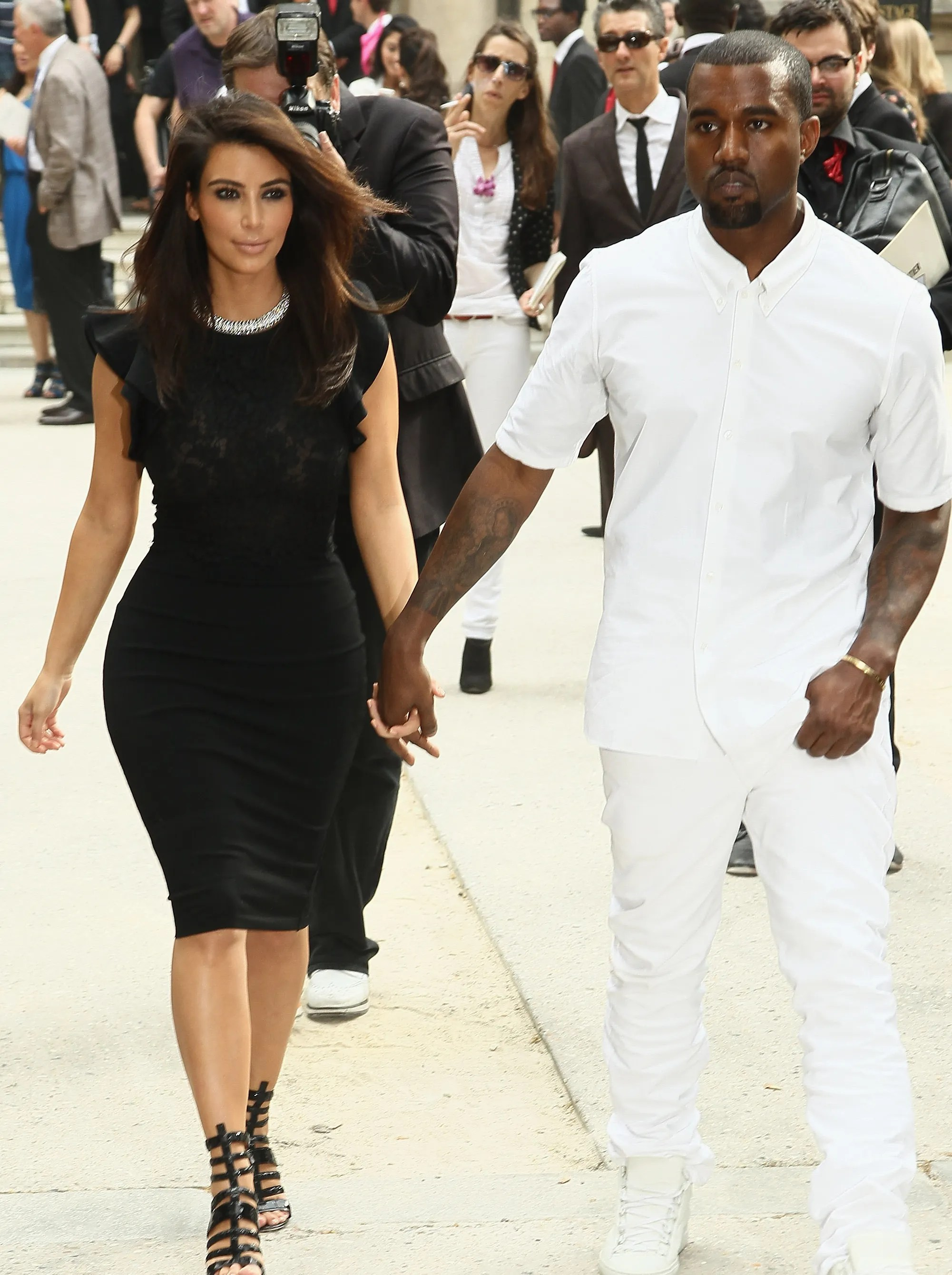 Monochromatic chic as the couple leaves the Valentino show in Paris on July 4, 2012.