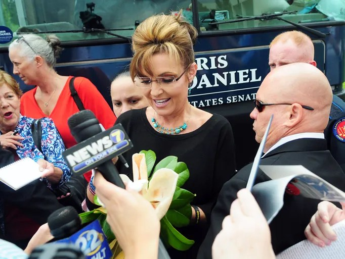 Former Alaska Gov. Sarah Palin leaves the Jones County Junior College Fine Arts Center in Ellisville Thursday after headlining a campaign rally for U.S. Senate candidate Chris McDaniel.