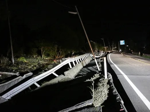 A road damaged by the 7.3 magnitude earthquake in Mashiki,