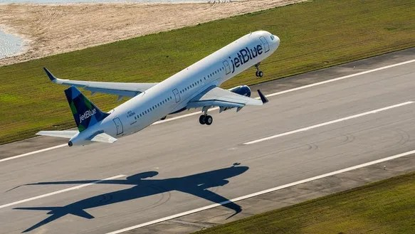 A JetBlue Airbus A321 takes off from Airbus' assembly