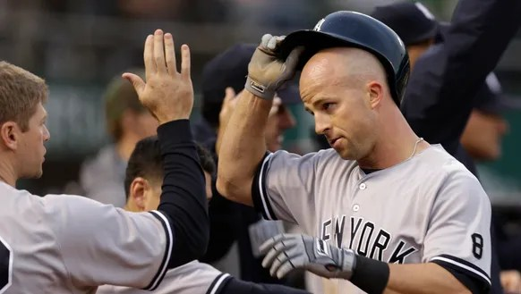 New York Yankees' Brett Gardner, right, is congratulated