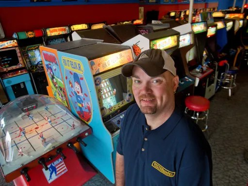 Ken Kalada stands in his Red Bank business, Yestercades,