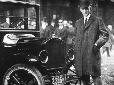 Henry Ford poses with a Model T in Buffalo, New York,