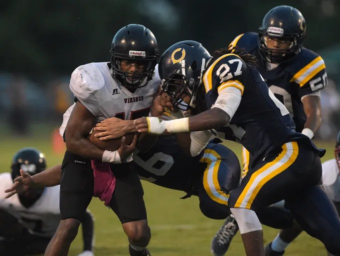 Northside quarterback Ethan Rose Jr. (17) is tackled by Carencro linebacker Xavier Brooks (27) on a run during the first half of an LHSAA football game at Carencro High School in Carencro, La., Friday, Sept. 12, 2014.  Paul Kieu, The Advertiser