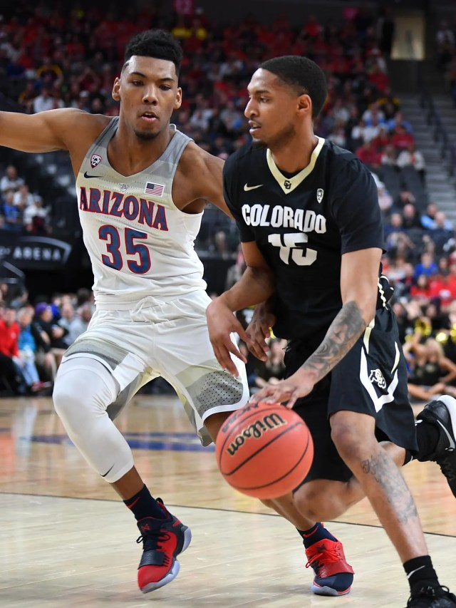 Colorado Buffaloes guard Dominique Collier (15) dribbles against Arizona Wildcats guard Allonzo Trier (35) during a quarterfinals match of the Pac-12 Tournament at T-Mobile Arena.