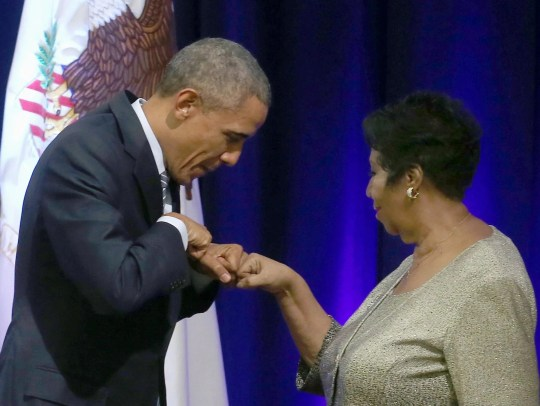 President Barack Obama fist bumps with Aretha Franklin