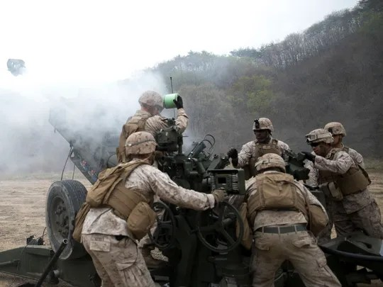 Artillery Marines fire off rounds from M777A2 lightweight