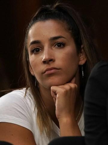Aly Raisman listens during a Senate hearing to focus