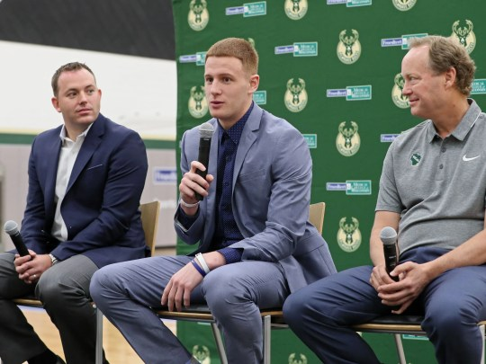 Donte DiVincenzo (center) answers questions with Bucks