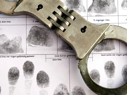 -CRIME cuffs over fingerprint sheet.jpg_20140114.jpg