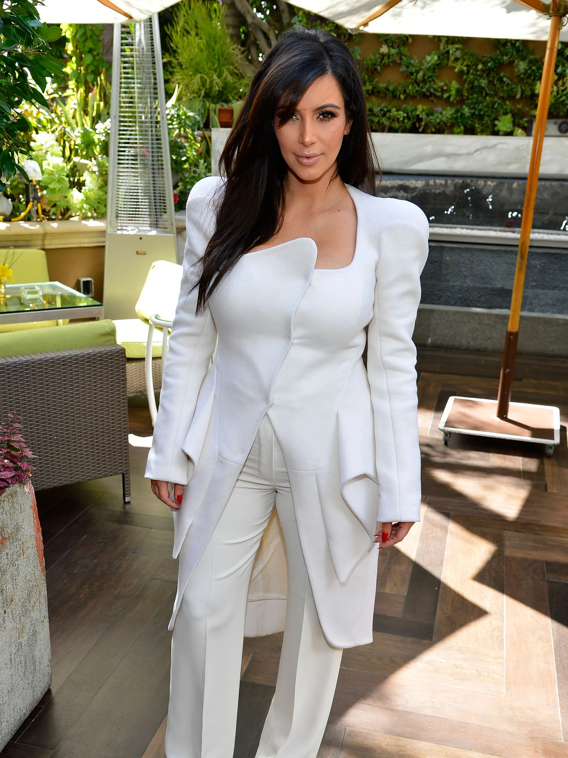 Since hooking up with West, Kardashian has favored stark, fitted white and black ensembles. Here she is at 'DuJour' magazine's bash in Los Angeles on March 2, 2013.
