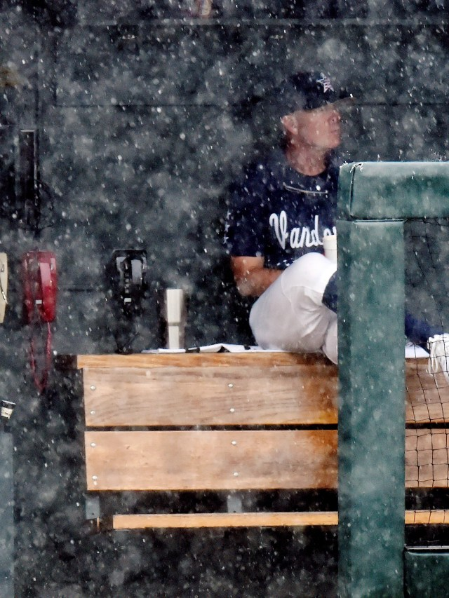 Vanderbilt coach Tim Corbin sits in the dugout during a rain delay before the start of a game against Tennessee on Sunday, April 30, 2017, in Nashville. The game was canceled.