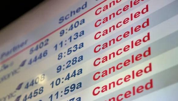 Screens display canceled flights at Newark Liberty