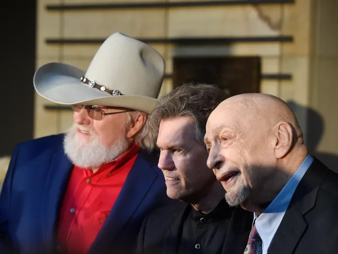 Charlie Daniels, Randy Travis and Fred Foster pose