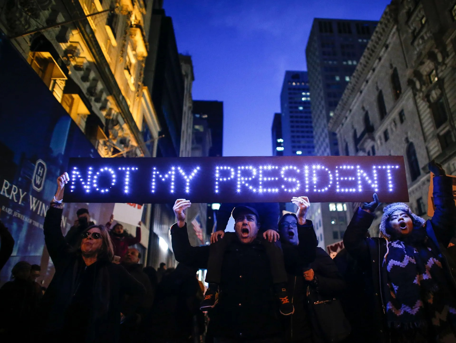 Demonstrators protest against President-elect Trump