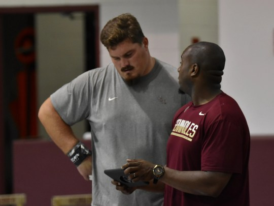 Austin Droogsma, left and FSU assistant track coach
