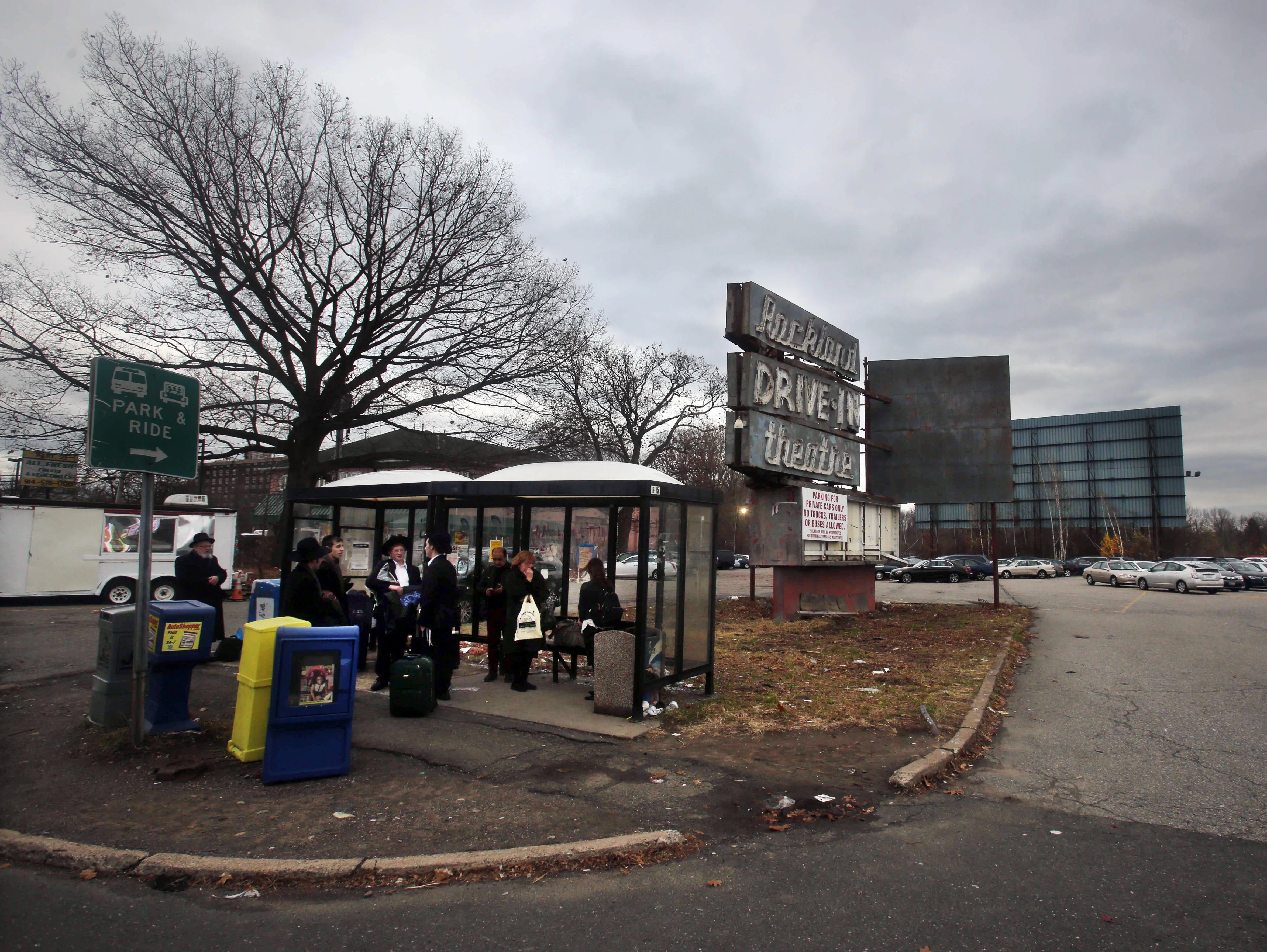 hight resolution of a bus stop in front of the old rockland drive in theater