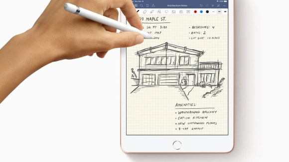 A person drawing and writing with an Apple Pencil on a new iPad mini