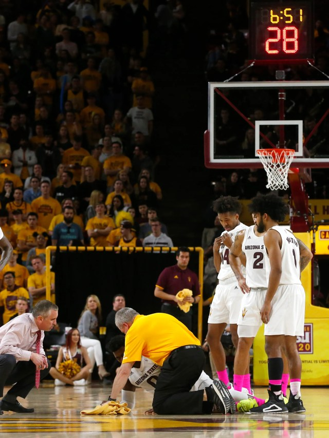 Arizona State Sun Devils head coach Bobby Hurley talks with guard Luguentz Dort (0) who took a hard fall during a men's basketball game against the California Golden Bears at Wells Fargo Arena in Tempe on February 24.