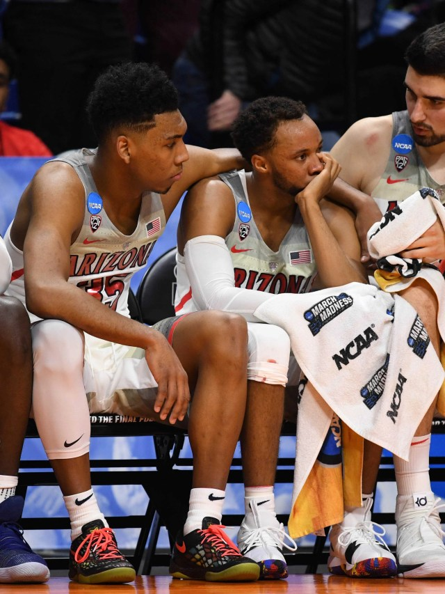 Mar 15, 2018; Boise, ID, USA; Arizona Wildcats guard Rawle Alkins (1), guard Allonzo Trier (35), guard Parker Jackson-Cartwright (0), and center Dusan Ristic (14) react on the bench in the second half against the Buffalo Bulls during the first round of the 2018 NCAA Tournament at Taco Bell Arena. Mandatory Credit: Kyle Terada-USA TODAY Sports