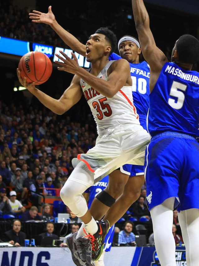 Mar 15, 2018; Boise, ID, USA; Arizona Wildcats guard Allonzo Trier (35) goes up for a shot as Buffalo Bulls guard Wes Clark (10) and guard CJ Massinburg (5) defend in the first half during the first round of the 2018 NCAA Tournament at Taco Bell Arena. Mandatory Credit: Brian Losness-USA TODAY Sports