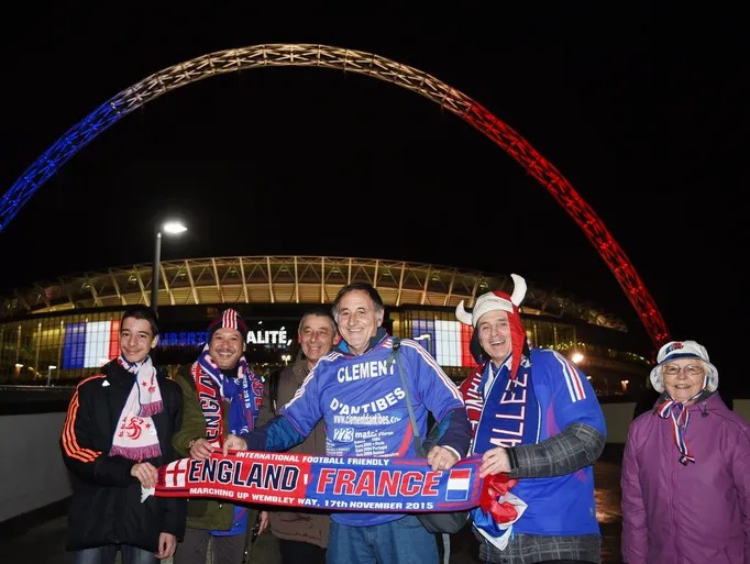 France supporters pose with the scarf showing the unity