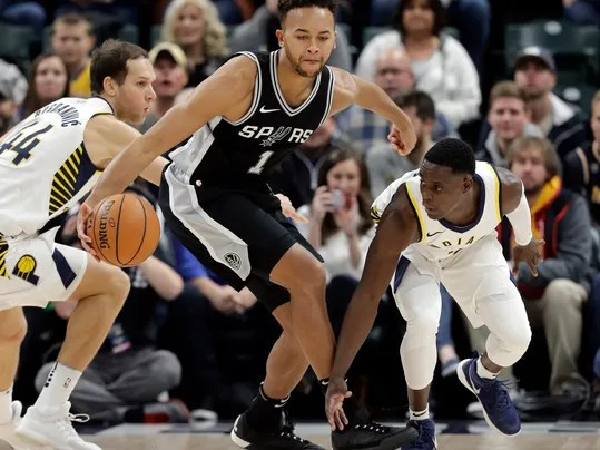San Antonio Spurs' Kyle Anderson (1) is defended by Indiana Pacers' Darren Collison (2) during the first half of an NBA basketball game, Sunday, Oct. 29, 2017, in Indianapolis. (AP Photo/Darron Cummings)