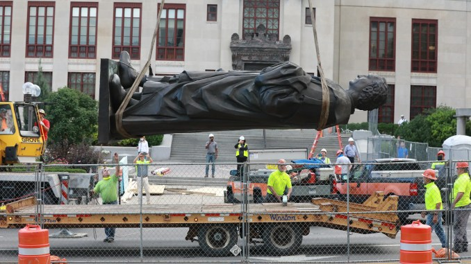 Workers remove the Christopher Columbus statue on the Broad Street side of Columbus City Hall Wednesday, July 1, 2020.