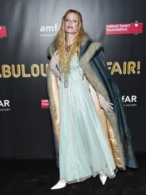 Model Carolyn Murphy vamped it off with a furry cape.