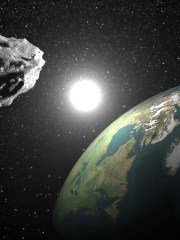 An illustration of an asteroid passing peaceably by Earth. An asteroid is projected to pass by Earth in September.