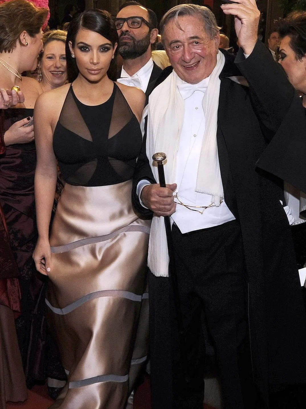 Kardashian and her host, Austrian businessman Richard Lugner arrive for the Vienna Opera Ball in Vienna, Austria on Feb. 27, 2014. At the event, she was accosted by a man in black-face.