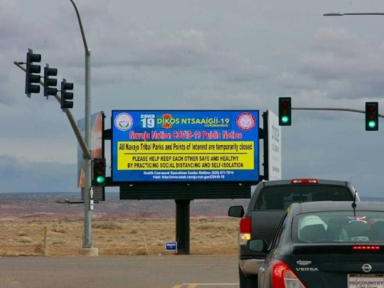 A sign on Navajo Nation land in Arizona warns drivers that parks and points of interest have been temporarily closed because of the coronavirus pandemic.