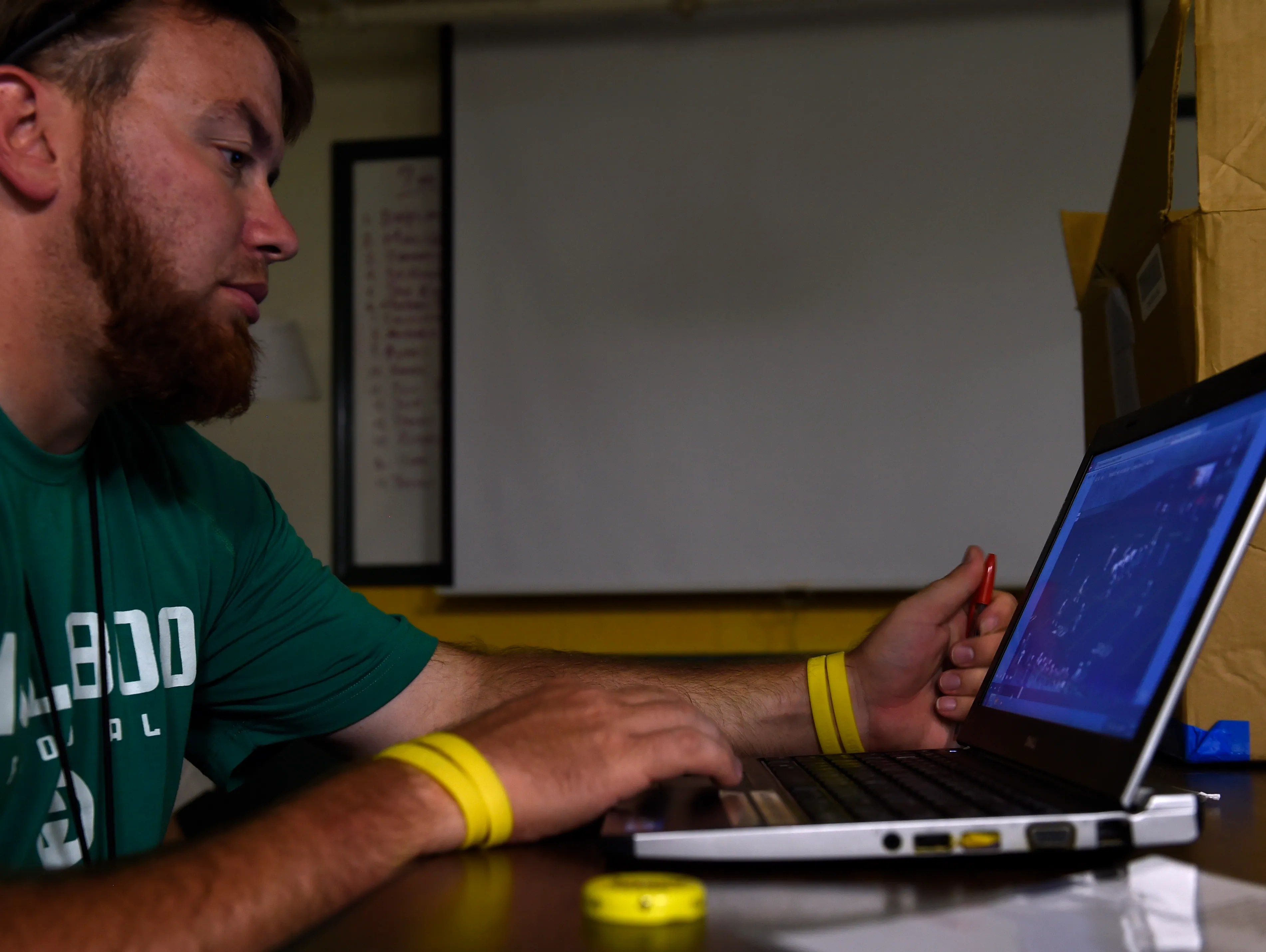 Hillsboro assistant coach Dustin Lopez uses video software to help compile game film to coach his players.