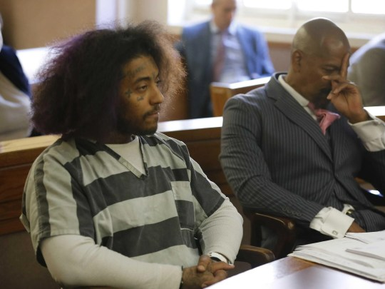 Rashaan Davis, 26, appears in Hamilton County court on Wednesday. Judge Alan Triggs, at the request of the county prosecutor's office, dropped a misdemeanor charge of violating the stay-at-home order against Davis, but a felony inciting violence charge remains pending. Davis' attorney, Clyde Bennett, argued the felony charge also should have been dismissed, saying Davis didn't do anything others haven't, which is chronicling what's going on in their neighborhood during the coronavirus pandemic.
