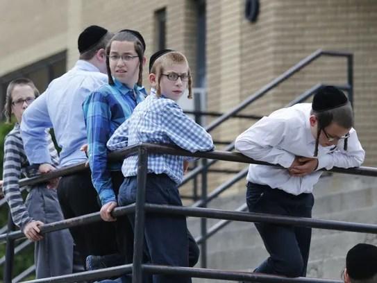 Boys stand outside a school in Kiryas Joel in July
