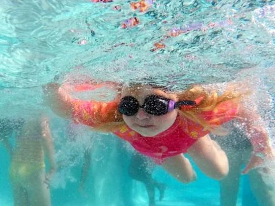 Kimberly Von Gries, 5, of Phoenix, swims under water