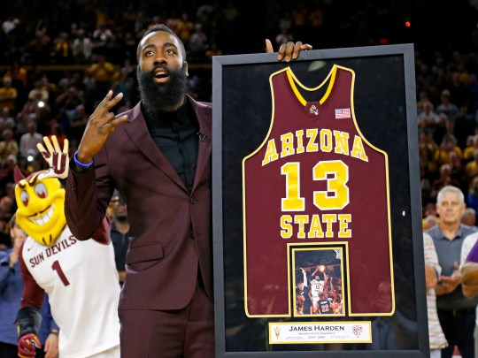 James Harden reacts during a ceremony honoring his