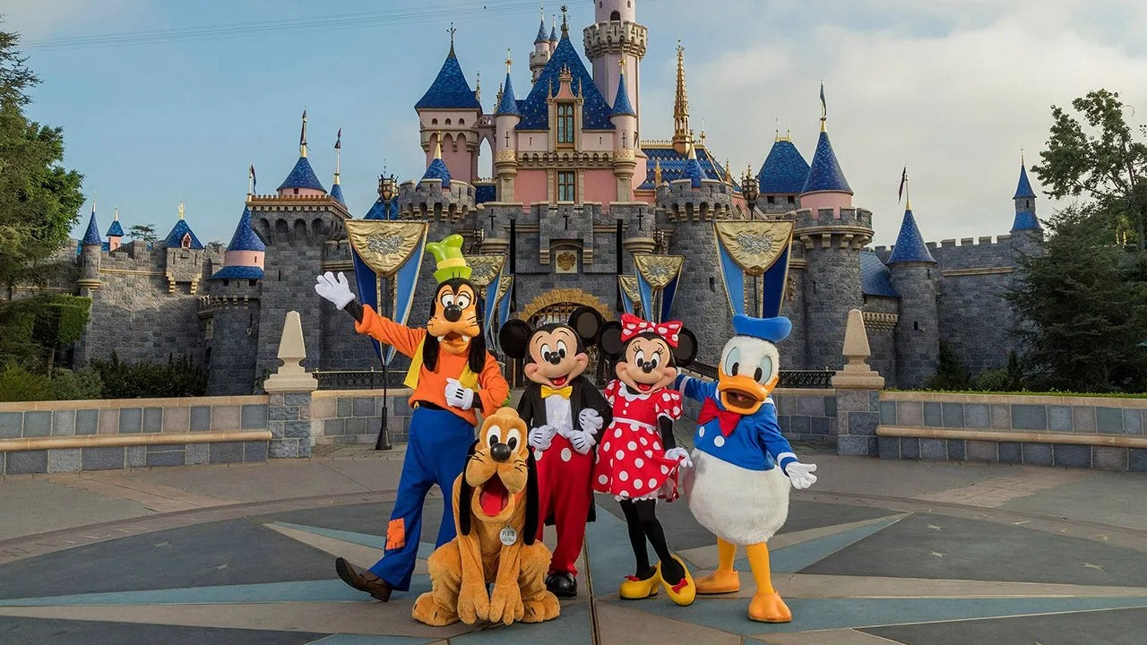 Disney characters in front of Disneyland's castle.