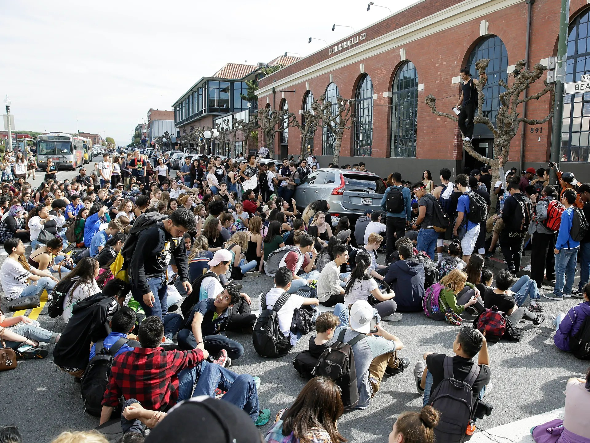 High school student protesters block Beach Street in