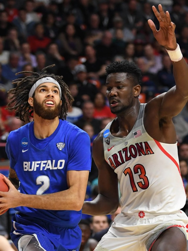 Mar 15, 2018; Boise, ID, USA; Buffalo Bulls guard Jeremy Harris (2) goes up for a shot as Arizona Wildcats forward Deandre Ayton (13) defends in the first half during the first round of the 2018 NCAA Tournament at Taco Bell Arena. Mandatory Credit: Kyle Terada-USA TODAY Sports