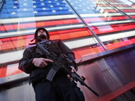 A heavily armed New York city police officer with the