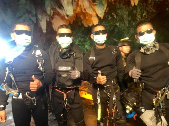 The last four Thai Navy SEALs emerge after completing the rescue mission inside a cave where 12 boys and their soccer coach were trapped since June 23.