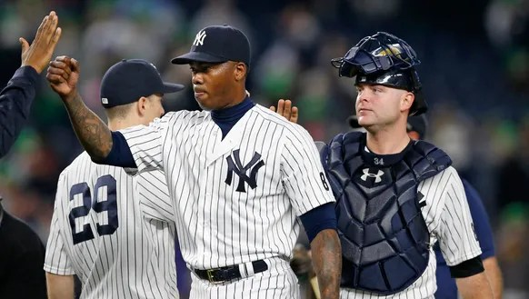 Teammates congratulate New York Yankees relief pitcher