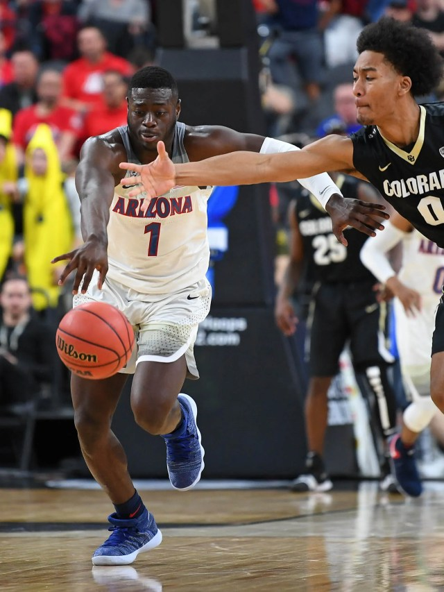 Mar 8, 2018; Las Vegas, NV, USA; Arizona Wildcats guard Parker Jackson-Cartwright (0) advances the ball below the reach of Colorado Buffaloes guard D'Shawn Schwartz (0) during a quarterfinal match of the Pac-12 Tournament at T-Mobile Arena. Mandatory Credit: Stephen R. Sylvanie-USA TODAY Sports