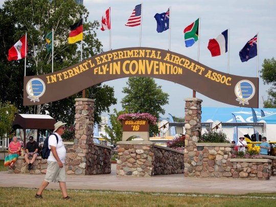 A convention goer passes next to the historic Brown Arch